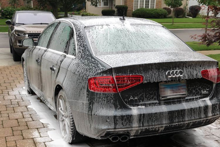 A Black Audi A4 in the process of being washed