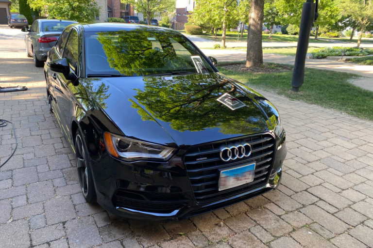 A Black Audi SUV shining after the wash